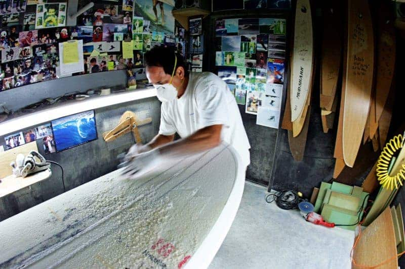 Jimmy crafts boards for Laird Hamilton