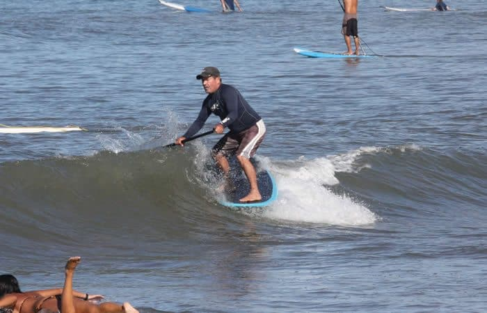 Jimmy Lewis Striker sup surf riding on the nose